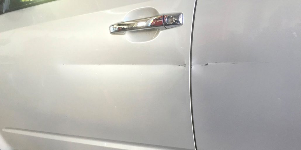 before-white-car-door-scratch-repair-weaverville-asheville-wnc